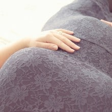 pregnant woman resting hand on tummy